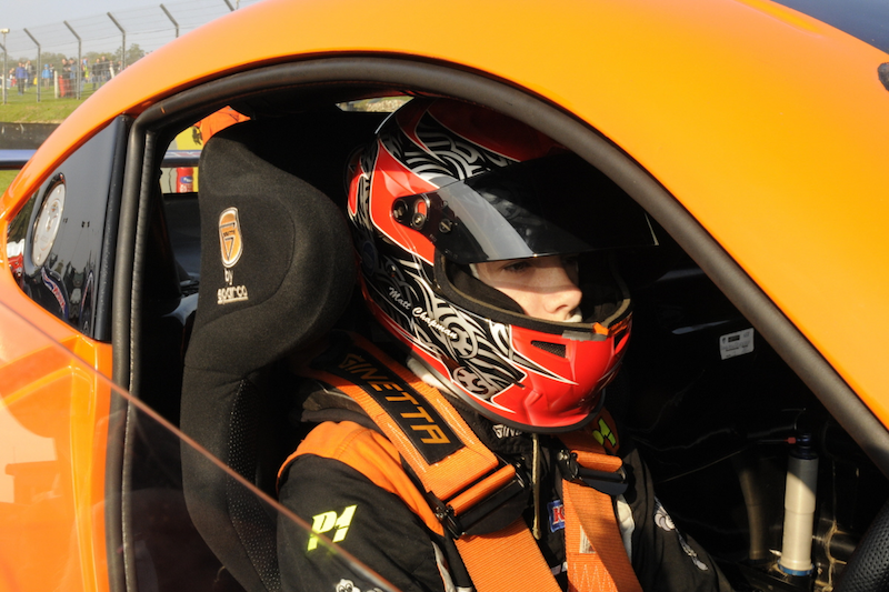 Matt Chapman sitting in his orange Ginetta Junior G40 ready to race